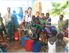 Women from local villages in Malawi gather to fill their buckets with safe drinking water for their families.